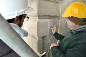 Stonemason and student at work.