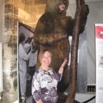Karen Parker, Chair of Unlocking Warwick, and the famous bear and ragged staff which greets visitors to the museum.