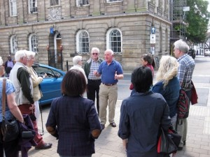 A tour group in front of the Court House
